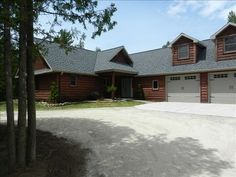 Baileys Harbor location. Rental for larger group. Log cabin home with circle driveway