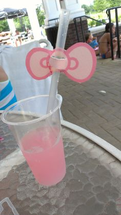 Hello Kitty Birthday Party....clear cups with pink bows & pink lemonade in a punch bowl for kenzies bday party!!!