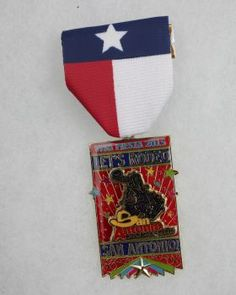 The San Antonio Stock Show & Rodeo's Fiesta Medal is both a detachable pin and medal. Sold out.Award: Second place, sports Photo: JUANITO M GARZA, By Juanito Garza, San Antonio Express-News / San Antonio Express-News