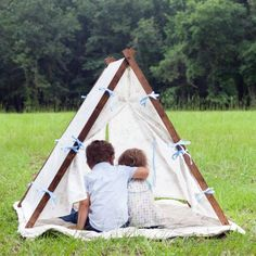 Make this simple Collapsible Fabric Play Tent for indoor or outdoor play. Folds up quickly to set aside or easily disassembles for travel.