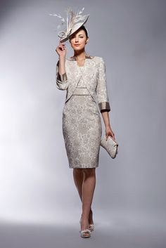 Caeli 150-152 (Presen Spring/Summer 2014) A beautiful jacquard print dress and jacket in gold and cream. The dress is gorgeous and has capped sleeves and a fabulous shaped and very edgy neckline. A nice wide waistband gives great shape and Read More...