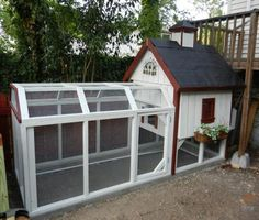 This little coop is as neat as a pin. I love the window box, cupola, and the gabled design of the top of the run.