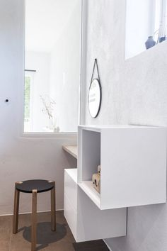 Bathroom details - a small make-up table in the corner with a window directly into the master bedroom. All kept in a Nordic style.