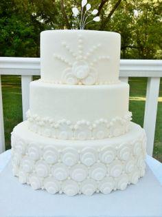 Peacock inspired wedding cake design