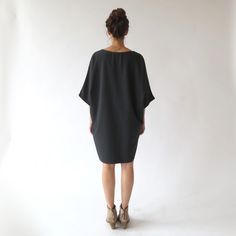 The Blair Dress is sure to be one of the most beloved pieces in your  closet. Made of a grainy-textured material, the Blaire has a wonderful  weight about it. The cut is airy and loose, but not unflattering due to its  draping feature. Whirl around the house or wear out and about–– it's an  easy and comfortable piece to just throw on and go. We love it worn alone  with chunky jewelry or over distressed jeans and patent oxfords.  Additionally, the dark charcoal tone is rich but works…