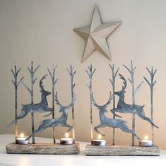 Charming seasonal tealight holder.Enchanting tealight holder pair with magical leaping reindeers in a choice of two metal finishes silver or rust on lime wood bases. Quite stunning on mantle pieces and side tables as the silhouettes of the reindeer once the tealights are lit create wonderful shadows on the wall behind or just as lovely placed on a window sill as a welcoming glow for visitors. Sold as a set of 2.Metal and wood.Each tealight L21.5cm x H27cm