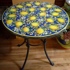 Lemons, a quintessentially Italian fruit, have made their way into and onto all manner of Italian products; including our beautiful hand painted Sicilian volcanic stone tables! Italian Pottery Outlet, Santa Barbara CA. Metal Patio Furniture, Table Furniture, Painted Furniture, Furniture Design, Pottery Painting, Ceramic Painting, Ceramic Table, Ceramic Pottery, Italian Patio