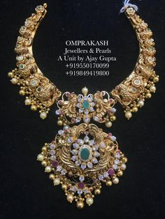 A Master piece Hand crafted Nakshi Kante Necklace! Beautiful kanti necklace with swan design motifs. Necklace studded with precious stones. Necklace with pearl and gold ball hangings. 1 Gram Gold Jewellery, Gold Jewellery Design, Gold Jewelry, Quartz Jewelry, Diamond Jewellery, Jewelry Shop, Gold Jhumka Earrings, Gold Choker, Gold Necklace