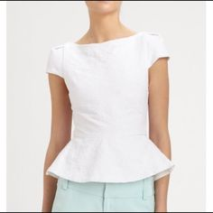 """Alice + Oliva White Roz Capsleeve Peplum Top A cute boatneck, cap-sleeve top with pretty peplum, has pleated shoulder detail, and a woven back panel with exposed back zipper. Boatneck cap-sleeve peplum pleated shoulder detail woven back panel exposed back zip about 20"""" from shoulder to hem. cotton/polyester/lycra. fully lined dry clean. Alice + Olivia Tops"""