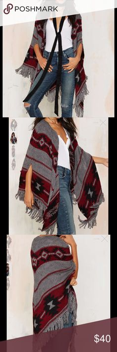 #754🦁🦃 Eastwood Marled Knit Poncho It's a wild world out there, wrap accordingly. The Eastwood Poncho is made in a gray marled knit and features red and black abstract design, fringe detail, and open front. We love it with skinnies and a Brixton hat, or over a lace maxi dress with vintage boots.  *Acrylic  *Runs true to size  *Model is wearing size S/M  *Dry clean only  *Imported Nasty Gal Sweaters Shrugs & Ponchos