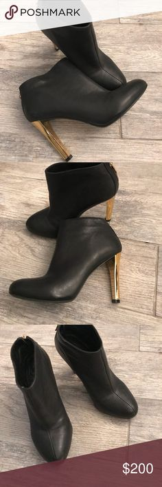 Tory Burch leather booties Black leather hotties with gold hardware logo  zipper and heels , in