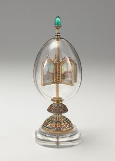 1896 Revolving Miniatures Egg. Gift: Emperor Nicholas II to his wife, the Empress Alexandra Fedorovna for Easter Made of rock crystal, it is surmounted by a large cabochon Siberian emerald finial. Owner: Bequest of Lillian Thomas Pratt, Museum of Fine Arts, Richmond, Virginia.  Height: 24.77 cm