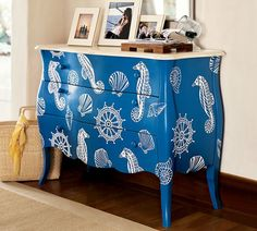 Nautical Entryway Cabinet from Pottery Barn - cheery blue and white with seahorses, shells and ships wheels. Could diy paint and stencil an old bureau, rather than shabby chic-ing it Nautical Entryway, Nautical Dresser, Blue Dresser, Coastal Dresser, Nautical Furniture, Coastal Furniture, Interior Design Blogs, Upcycled Furniture, Diy Furniture