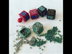 Leslie demonstrates how to make a square using peyote stitch, then how to build up two squares to make a cube bead that can be strung or used as an element o.Leslie shows you how to make her new open heart element pattern by using peyote stitch with incre Beaded Bracelet Patterns, Peyote Patterns, Beaded Earrings, Beaded Bracelets, Art Patterns, Mosaic Patterns, Knitting Patterns, Weaving Patterns, Seed Bead Tutorials