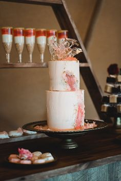 Wedding Inspiration from debbiecarlisle.comUnusual style wedding cake with pretty peach and gold colouring