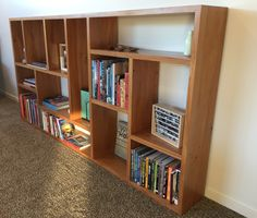 A rimu bookshelf made from timber recycled out of a commercial project