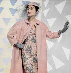 1954 Model in pink and gray print silk dress, the lining of the pink wool coat matches the dress, by Jacques Fath