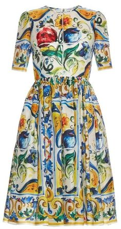 This white silk-organza midi dress is a beautiful showcase of Dolce & Gabbana's summery Majolica pattern which is inspired by traditional Sicilian tiles. (Oooooooo. Yeah I would wear that!)
