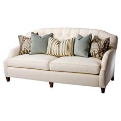 Tufted sofa with Qualax foam and Springdown cushions.         Product: Sofa with 4 standard pillows and 1 back pillow