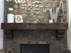 Custom fireplace mantel made from a cedar beam. The corbels are also cut from a cedar beam. The wood is finished with Briwax in Dark Brown. Mantel handcrafted by L. STEPHENS TRADING CO.