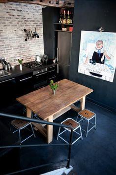 Black stylish kitchen with fun wall art - industrial interior design