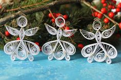 Hey, I found this really awesome Etsy listing at https://www.etsy.com/listing/210887468/set-of-3-white-quilled-angels-quilling