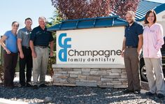 Tribune photo -- Doctors at Champagne Family Dentistry stand outside their Sparks Boulevard location Wednesday. The family practice has been in Sparks for more than 30 years and continues to support the community they were raised in.