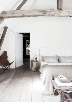 = beams and butterfly chair white bedroom