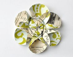 paper flower from a circle punch! Here's the direct link to the tutorial:  http://octoberafternoon.typepad.com/october_afternoon/2011/03/tuesday-tutorial-paper-flowers.html