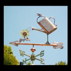 WATERING CAN WITH FLOWERS Weather Vane by West Coast Weather Vanes. This watering pot with flower can be made using a variety of metals with optional gold or palladium leaf accents. Georges Chelon, West Coast Weather, Storefront Signs, Lightning Rod, Weather Vanes, Outdoor Signs, Water Flowers, Objet D'art, Roosters