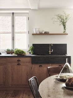 stunning black concrete farmhouse sink with walnut cabinets