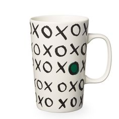 A ceramic coffee mug with an XOXO pattern design, part of the Starbucks Dot Collection.