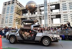 A 'Back to the Future' style DeLorean, powered by methanol bio-fuel made from recycled clothing produced by a Japanese venture, is displayed before hundreds of movie fans on the rooftop of a shopping mall in Tokyo on October 21, 2015 for the 30th anniversary of the Hollywood movie 'Back to the Future'. AFP PHOTO / Yoshikazu TSUNO