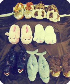 Plush, warm animal slippers for adult include tigers, bulldogs, pigs, bunnies, dinosaurs, sharks, and lions.