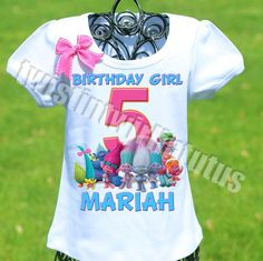 A fun, playful Trolls birthday shirt personalized with your child's name and age. All shirts are 100% cotton. I use a professional heat press to transfer the i
