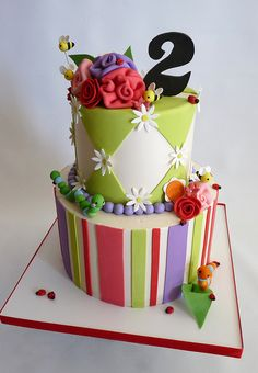 Diamond and strips cake with flowers and bugs
