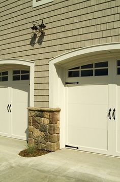 I love this combination of the white garage doors, siding, and stone.