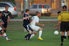 Joe Brown shields off his opponent from the ball.