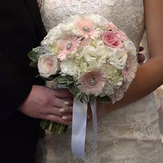 Love the bouquet and the bride's pale nail color to match
