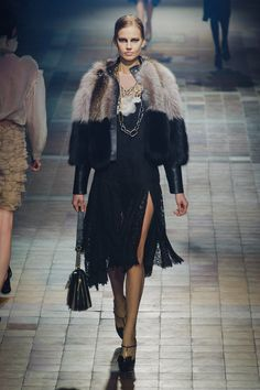 Pin for Later: Fall in Love With the Lanvin Runways Fall 2013 Silky, sexy dresses were topped off by fur for an extra dash of luxury.