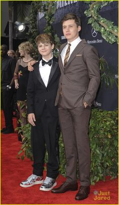 Zach Mitchell portrayed by Nick Robinson in Jurassic World. Gray Mitchell portrayed by Ty Simpkins in Jurassic World.