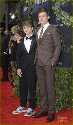 Zach Mitchell portrayed by Nick Robinson in Jurassic World. Gray Mitchell portrayed by Ty Simpkins in Jurassic World.