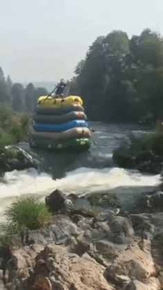 stacked rafts... - (rafting)(tall)(river) - #rafts #raft #rafting #stacked #tall #river #animatedgif
