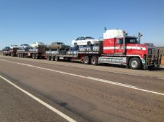 Cars stacked on load on road train