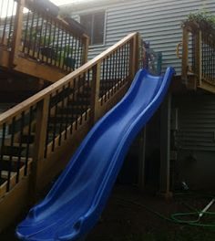 Deck stairs and 14 foot slide. (Stairs still need a 2nd rail and at this point are probably more dangerous than the slide!)