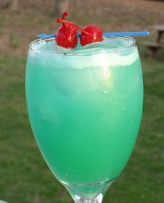 Blue Hawaiian (2 oz. Light Rum 1 oz. Blue Curacao 1 oz. Cream of Coconut 2 oz. Pineapple Juice)