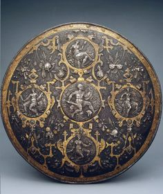 Pageant Shield, Place of creation: Italy Date: Second half of the 16th century Material: steel Technique: chased and gilded Dimension: diam. 60 cm.