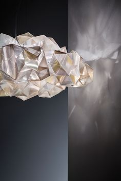 -Inspired Light Fixtures by Adriano Rachele - Design Milk : The crystal-inspired Drusa fixtures, designed for SLAMP, create a kaleidoscope effect whenever the light hits its many faceted surfaces and angles. Luxury Lighting, Modern Lighting, Lighting Design, Lighting Ideas, House Doctor, Plywood Furniture, Chandeliers, Contemporary Light Fixtures, Suspended Lighting