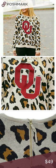 OU Leopard Sweater This sweater is so cute for Fall game days! The back has a zipper closure to add to the cuteness :)   🏈100% Cotton  🏈Bundle for additional discounts and private offers!  🏈 Available in S and M  Suggested User / 175+ Items Sold / Posh Party Host Sweaters Crew & Scoop Necks