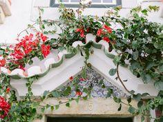 Typical Portuguese blue tiles house entrance with red buganville Portuguese Tiles, Blue Tiles, House Entrance, Lisbon Portugal, Algarve, Engagements, Destination Wedding Photographer, Couple Photography, Floral Wreath